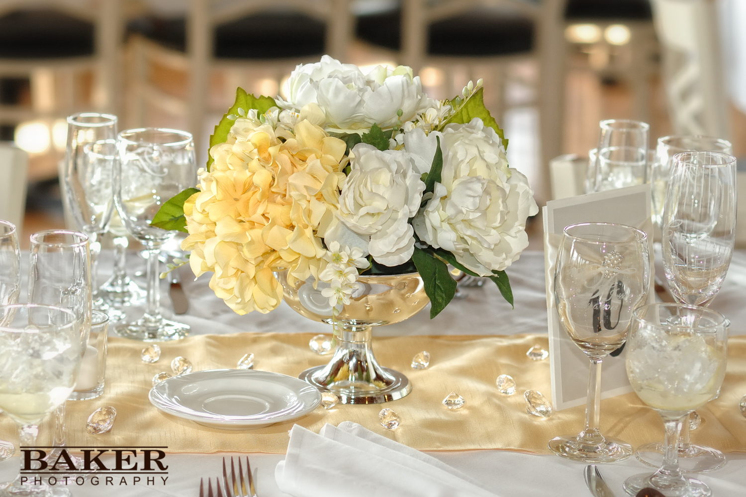 Wedding reception table setting with centerpiece – Photo credit Baker Photography