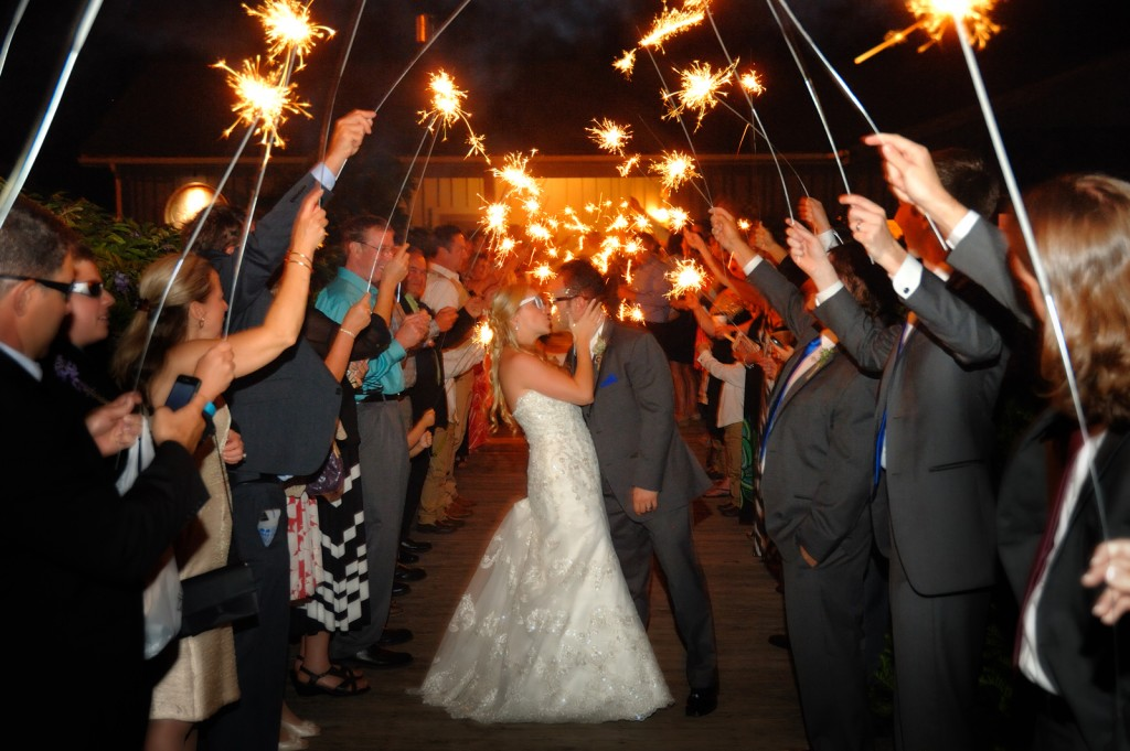 Reception procession with sparklers on the wisteria walkway – Photo credit Baker Photography